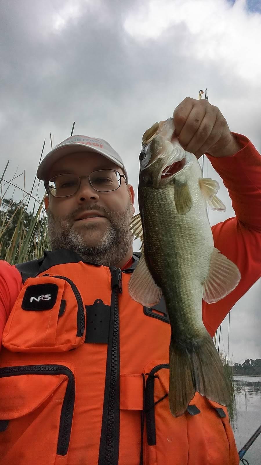 Holding Largemouth bass while kayak fishing Lake Bastrop Texas