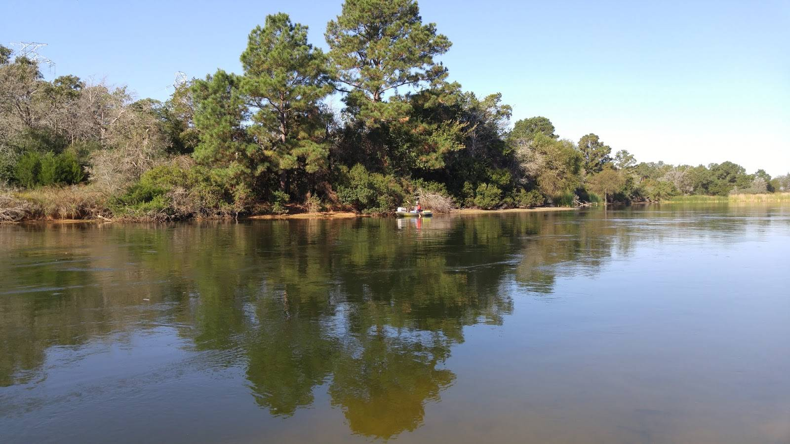 Kayak Fishing Lake Bastrop on a beautiful day with calm water