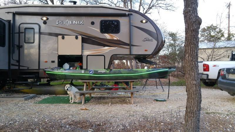 Our 5th Wheel RV sitting at our home site with Kayak and our dog.
